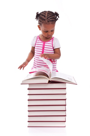 Cute black african american little girl reading a book, isolated on white background - African people - Children Stock Photo - 19665288