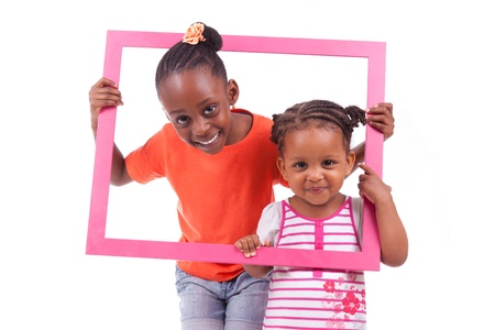african american infant: Portrait of a cute little african american girls, holding a picture frame,isolated on white background
