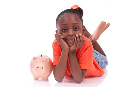 white piggy bank: Cute little black girl with a smiling piggy bank, isolated on white background - African children Stock Photo