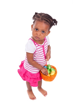 angry child: African Asian girl holding chocolate ester egg, isolated on white background Stock Photo