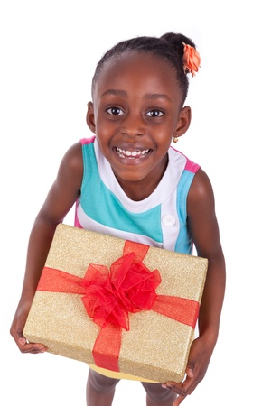american children: Young African American little girl holding a gift box, isolated on white background