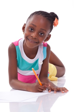 Cute black african american little girl drawing, isolated on white background - African people - Children photo