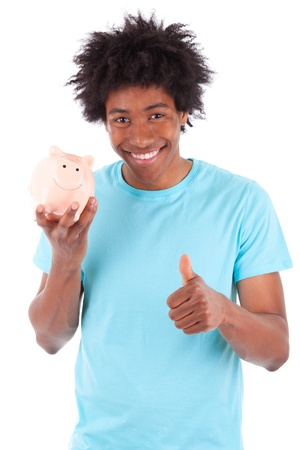 teenage male: Young black teenage men holding a piggy bank and making thumbs up , isolated on white background - African people