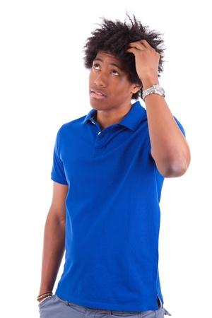 hesitating: J�venes reflexivos negros adolescentes que muestran los pulgares para arriba, aislado en fondo blanco - la gente de �frica