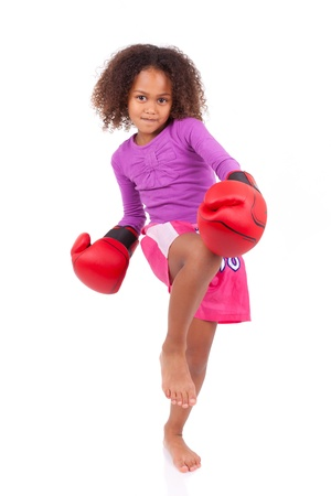 boxing equipment: Little muay thai boxing girl using her knee,isolated on white background