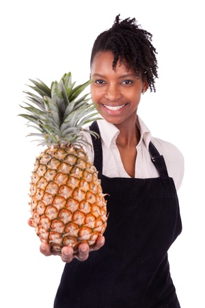 Young happy black   african american woman holding a fresh melon isolated on white background photo