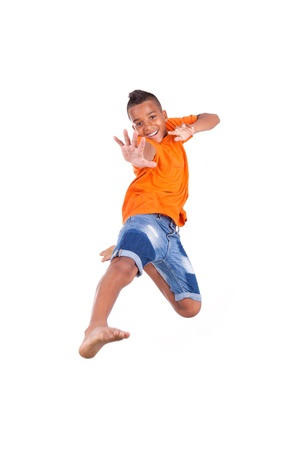 kid  playing: Portrait of a cute teenage black boy jumping over white background - African people Stock Photo