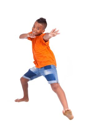 Portrait of a cute teenage black boy jumping over white background - African people Stock Photo - 21307797