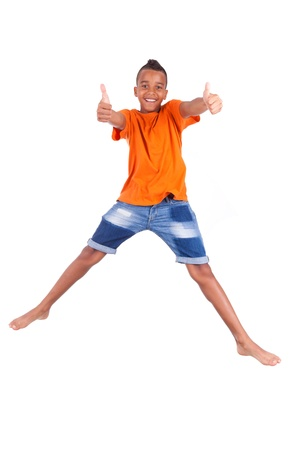 Portrait of a cute teenage black boy jumping over white background - African people Stock Photo - 21307798