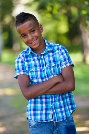 Outdoor portrait of a cute teenage black boy - African people Stock Photo - 21307801
