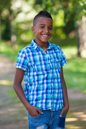 Outdoor portrait of a cute teenage black boy - African people Imagens
