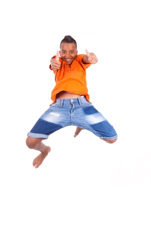 air jump: Portrait of a cute teenage black boy jumping over white background - African people Stock Photo