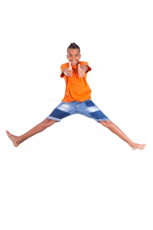 afro caribbean: Portrait of a cute teenage black boy jumping over white background - African people Stock Photo