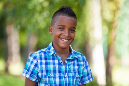 Outdoor portrait of a cute teenage black boy - African people Stock Photo