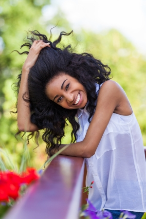 Outdoor portrait of a smiling teenage black girl - African people Stock Photo - 21431211