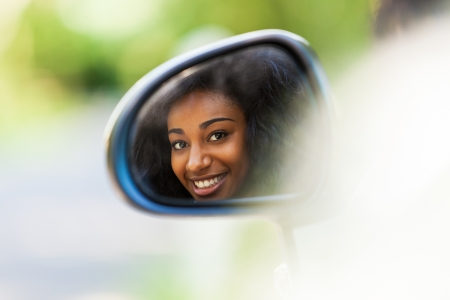 Young black teenage driver seated in her new convertible car - African people Stock Photo - 21656405