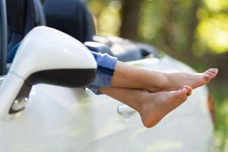 Young black woman driver taking a rest in her convertible car - African people Stock Photo - 21656414