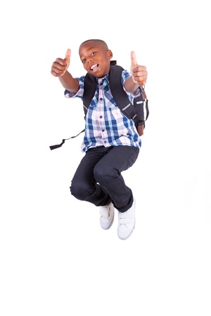 African American school boy jumping and making thumbs up , isolated on white background - Black people photo