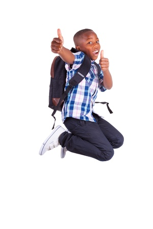 African American school boy jumping and making thumbs up , isolated on white background - Black people