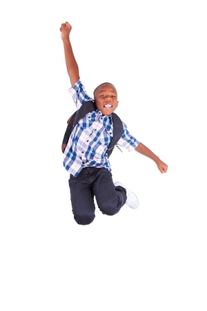 jump: African American school boy jumping , isolated on white background - Black people