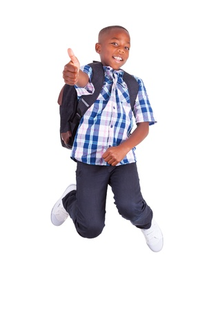 school bags: African American school boy jumping and making thumbs up , isolated on white background - Black people