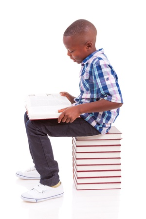 African American school boy reading a book, isolated on white background - Black people photo