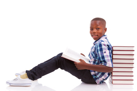 african american boy: African American school boy reading a book, isolated on white background - Black people