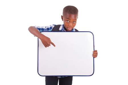 African American school boy holding a blank board, isolated on white background - Black people Stock Photo