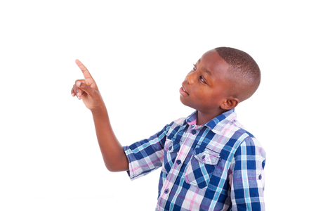 child looking up: African American school boy looking up, isolated on white background - Black people Stock Photo