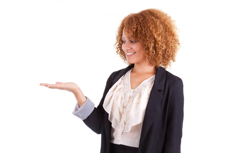 south american: Portrait of a young african american business woman holding something in her hand palm, isolated on white background - Black people