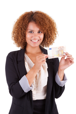 Young african american business woman holding a euro bill, isolated - African people photo