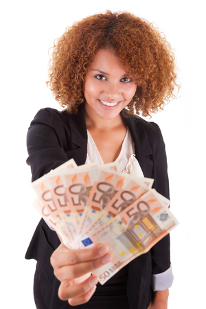 woman holding money: Young african american business woman holding euro bills, isolated on white background - African people