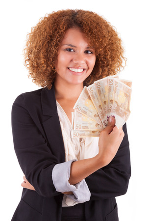 happy rich woman: Young african american business woman holding euro bills, isolated on white background - African people