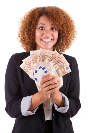 brazilian woman: Young african american business woman holding euro bills, isolated - African people Stock Photo