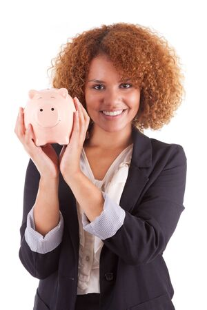 american money: Young african american business woman holding a piggy bank, isolated on white background - African people