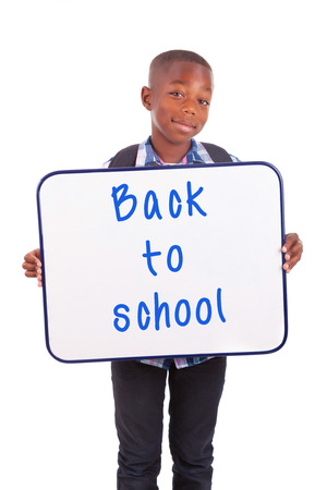 African American school boy holding a blank board, isolated on white background - Black people photo