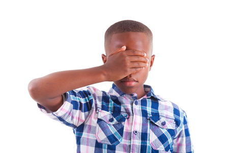 blind child: African American boy hiding eyes, isolated on white background  - Black people