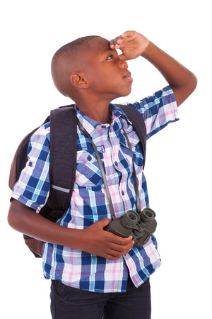 African American school boy holding binoculars, isolated on white background - Black people photo