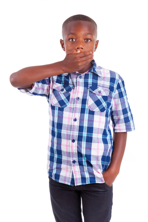 voiceless: African American boy hiding mouth, isolated on white background  - Black people