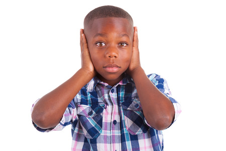 voiceless: African American boy hiding ears, isolated on white background  - Black people