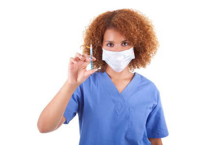 nurse injection: African American nurse holding a needle, isolated - Black people Stock Photo