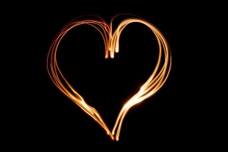 neon wallpaper: Light painting heart shape over