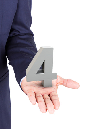 Business man holding a 3d number in hand palm, isolated on white background photo