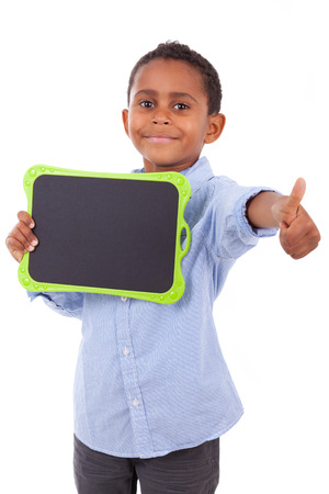 African American school boy holding a blank  black board, isolated on white background - Black people Stock Photo