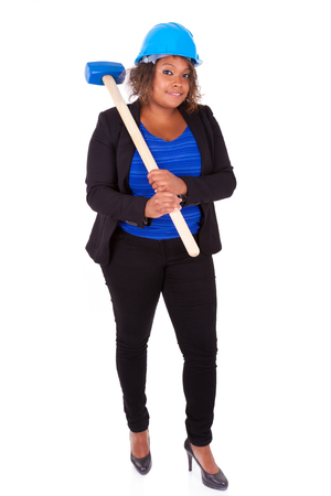 sledge hammer: African American woman holding a demolition hammer, isolated on white background  - Black people