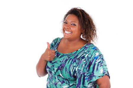 white with black: Mujer afroamericana sonriente haciendo el pulgar encima de, sobre fondo blanco - negros