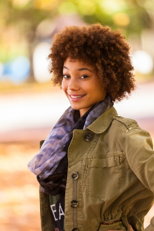 natural hair: Autumn outdoor portrait of beautiful African American young woman - Black people Stock Photo