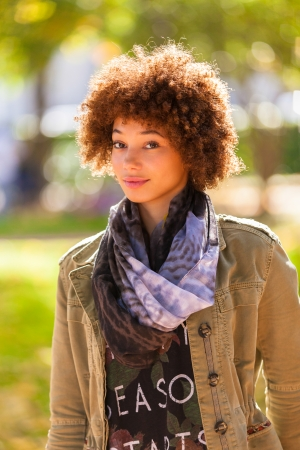 Autumn outdoor portrait of beautiful African American young woman - Black people photo