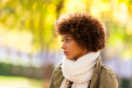 south american ethnicity: Autumn outdoor portrait of beautiful African American young woman - Black people Stock Photo