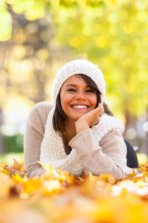 Autumn outdoor portrait of beautiful young woman - Caucasian people photo